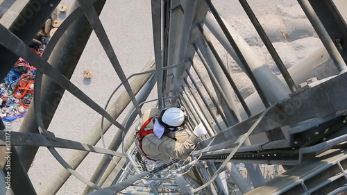 Man to tower climber on height structure