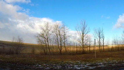 Spring Driving View with Last Snow, Dramatic Blue Skies and Clou