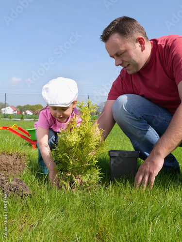 Dad and daughter gardening