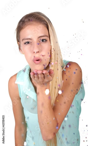 Pretty Blond Girl Blowing Confetti