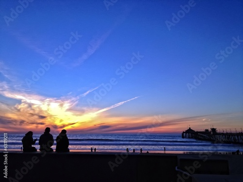People Watching a Sunset Over the Pacific Ocean, USA