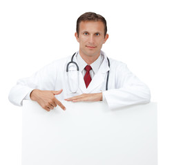 Happy doctor showing blank clipboard sign.
