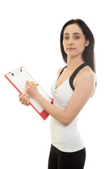 Female Fitness trainer with paper