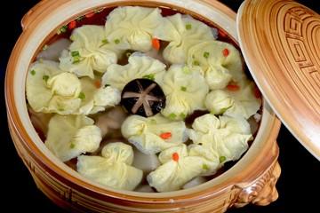 Chinese Food:Boiled dumplings in a pot