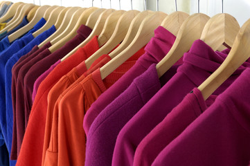 female colorful clothes on Hangers
