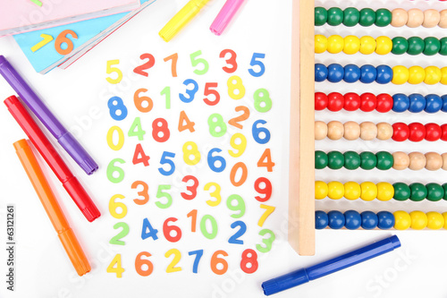 Colorful numbers, abacus, books and markers, isolated on white