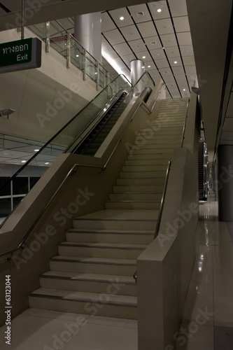 staircase with railings, indoor,