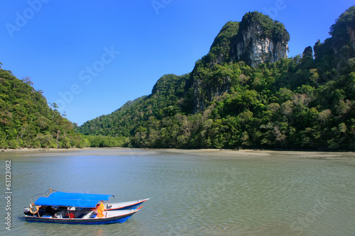 Tourist boats at Island of the Pregnant Maiden lake, Marble Geof