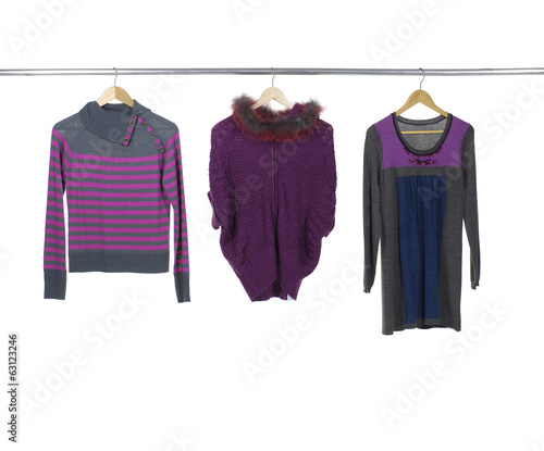 Set of three female clothing hanging on hangers