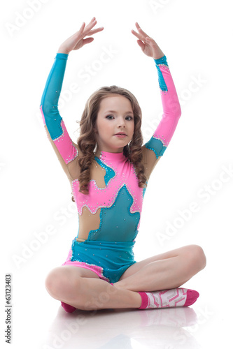 Image of cute little girl doing gymnastics