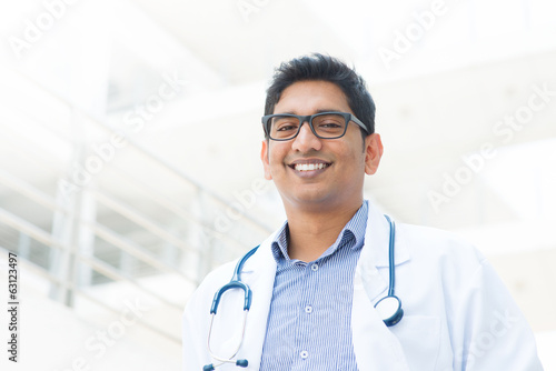 Smiling Asian Indian male medical doctor