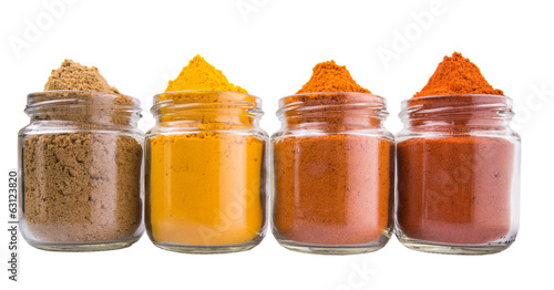 Various spices over white background