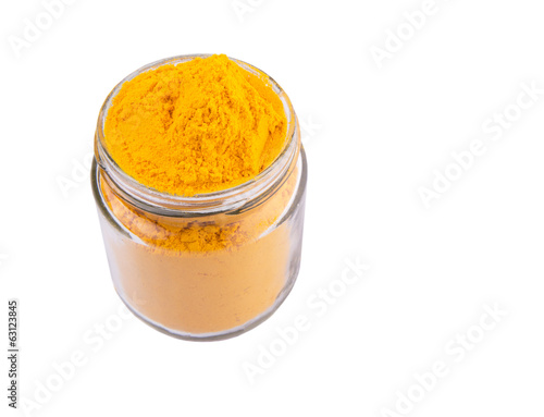 Turmeric powder spices over white background