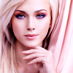 Beautiful sensual woman with pink silk.