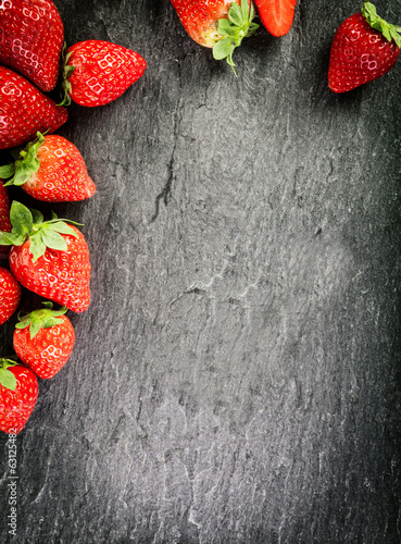 Border of whole fresh ripe red strawberries