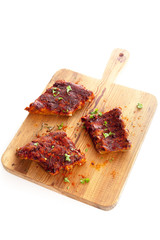 Portions of spicy BBQ ribs