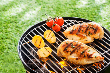Lean healthy chicken breasts on a BBQ