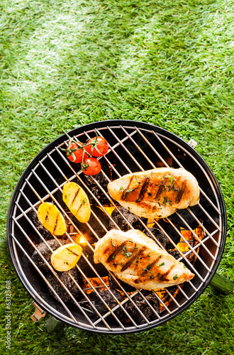 Healthy summer BBQ with chicken on the coals