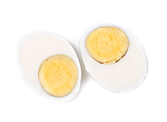Two halves of a boiled egg.