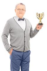 Mature man holding a trophy