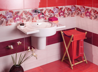 detail of a modern bathroom with floral motif tiles and accessor