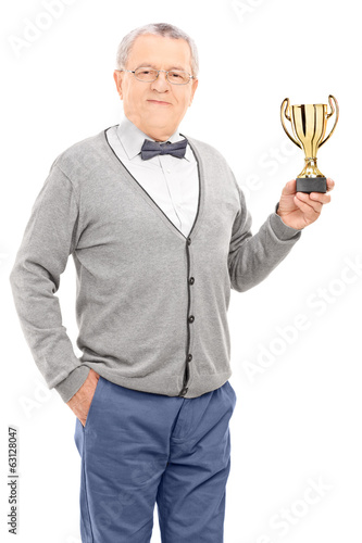 Mature man holding a trophy
