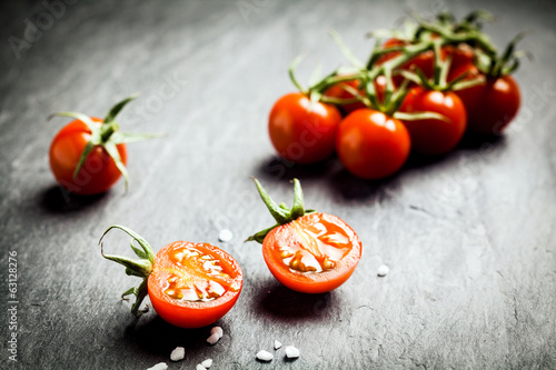 Halved fresh ripe grape tomato