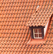 Tile roof with a window as a background