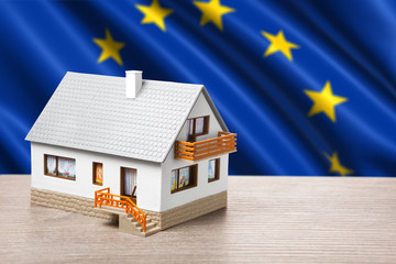 classic house against EU flag background