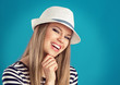 Happy girl wearing striped clothing and white summer hat