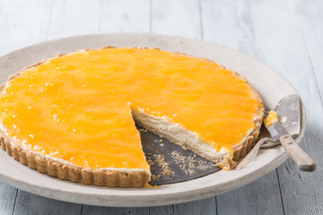 Delicious homemade cheese cake with passion fruit topping