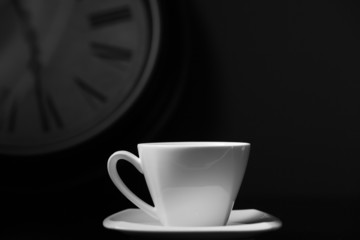 cup of coffe with clock on background black and white