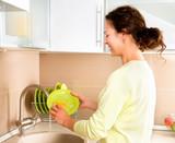 Woman Washing Dishes. Kitchen