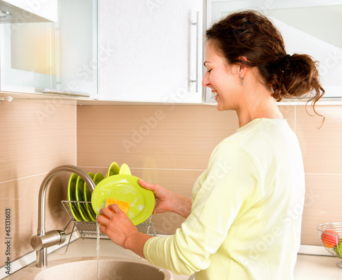 Woman Washing Dishes. Kitchen