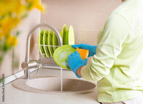 Woman Washing Dishes. Kitchen. Dishwashing