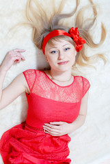 beautiful funny young pinup woman in red dress