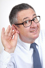 Man holding his ear to hear better
