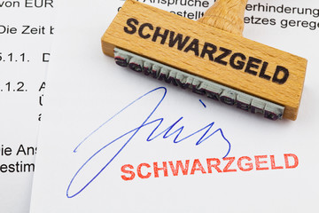Holzstempel auf Dokument: Schwarzgeld