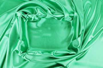 Square in emerald fabric.