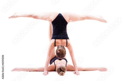 two gymnasts women in splits support position