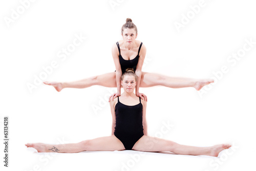 two beautiful athlete women in splits
