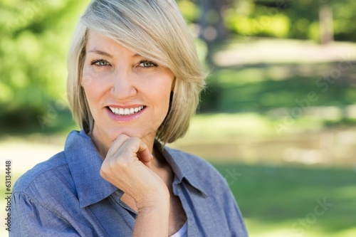 Portrait of happy woman in park