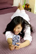 Happy beautiful asian girl making selfie with mobile phone