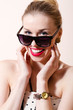 Beautiful blond pinup woman with sunglasses