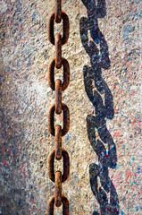 rusty chain and shadow