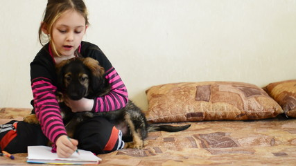 girl doing lessons together with your puppy