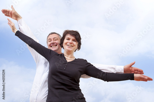 Man and woman bubbling over joie de vivre