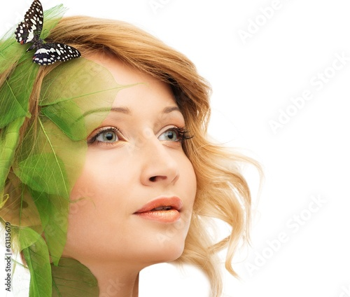 Dreaming young woman in conceptual spring costume with butterfly