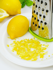 Lemon and lemon zest with grater