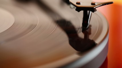 Two wedding rings lying on playing phonograph record